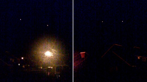 Two glowing orange lights fly silently across the sky over Henley-in-Arden.
